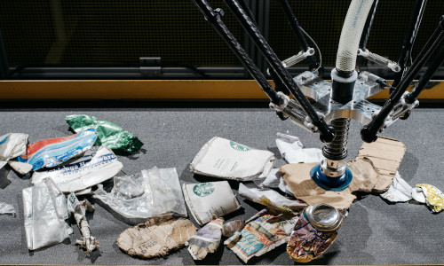 An AMP Robotics system sorting recyclable material at the company's lab.